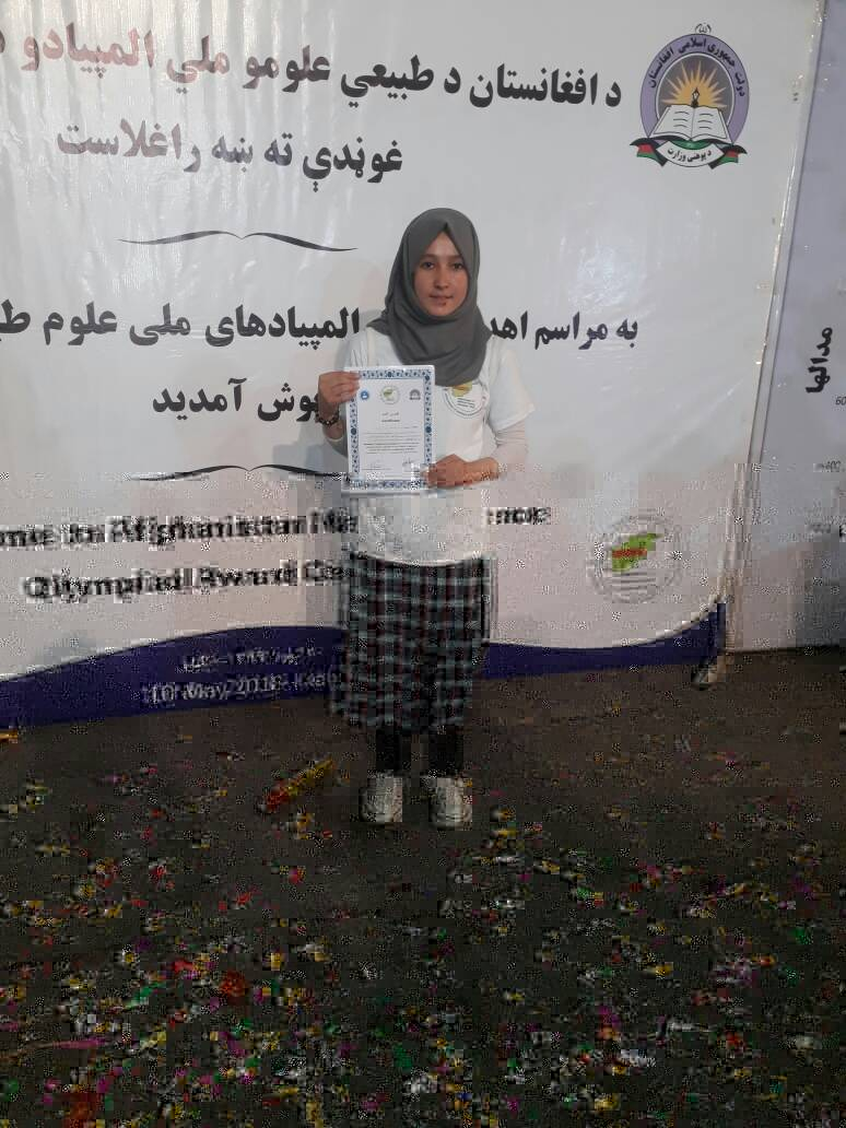 One of our Shafia Scholarship Recipients proudly shares her certificate
