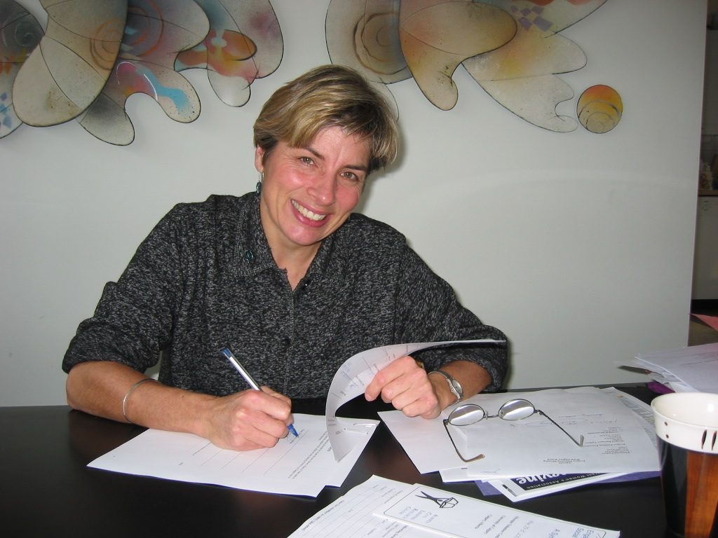 Co-founder Janice Eisenhauer, signing CW4WAfghan's first organization by-laws in 1998.